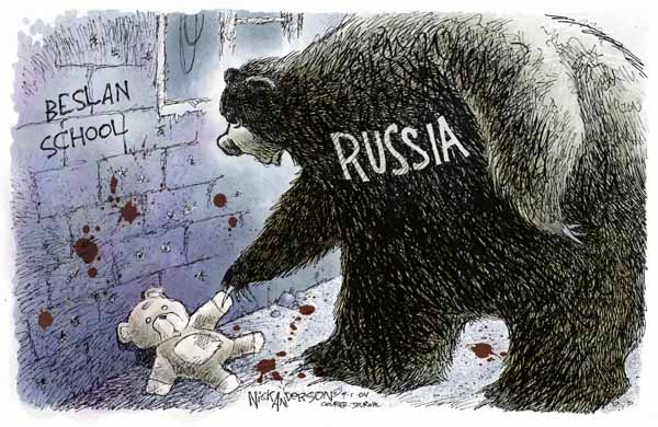 No caption.  (Russian bear picks up a teddy bear left against the wall of the Beslan School.)