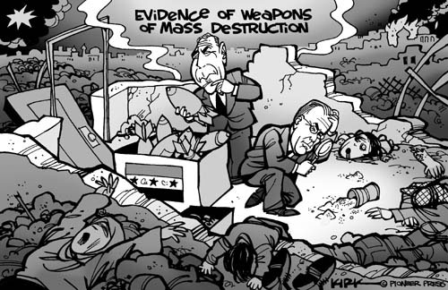 Evidence of Weapons of Mass Destruction.  (President George W. Bush and Secretary of Defense Donald Rumsfeld examine small bombs and spilled cannister as they are surrounded by death and destruction caused by liberation of Iraq.)