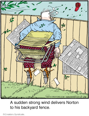 A sudden strong wind delivers Norton to his backyard fence.