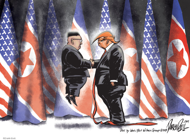 No caption (Kim Jong Un is lifted off the ground as he shakes hands with Donald Trump).