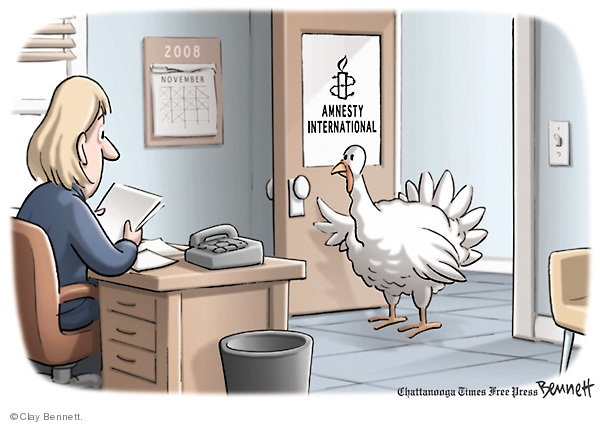 No caption. (A turkey goes to Amnesty International to save his life at Thanksgiving.)