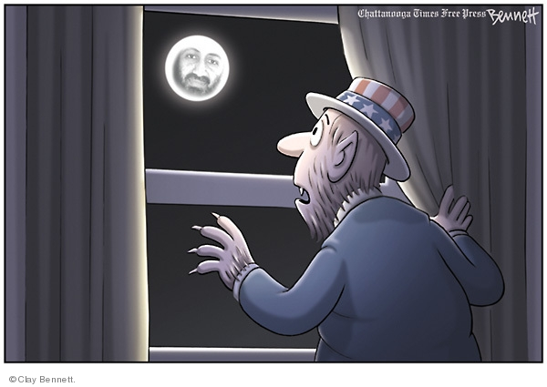 No caption. (A full moon, bearing the face of Osama Bin Laden, shines down on and American who has turned into a werewolf.)