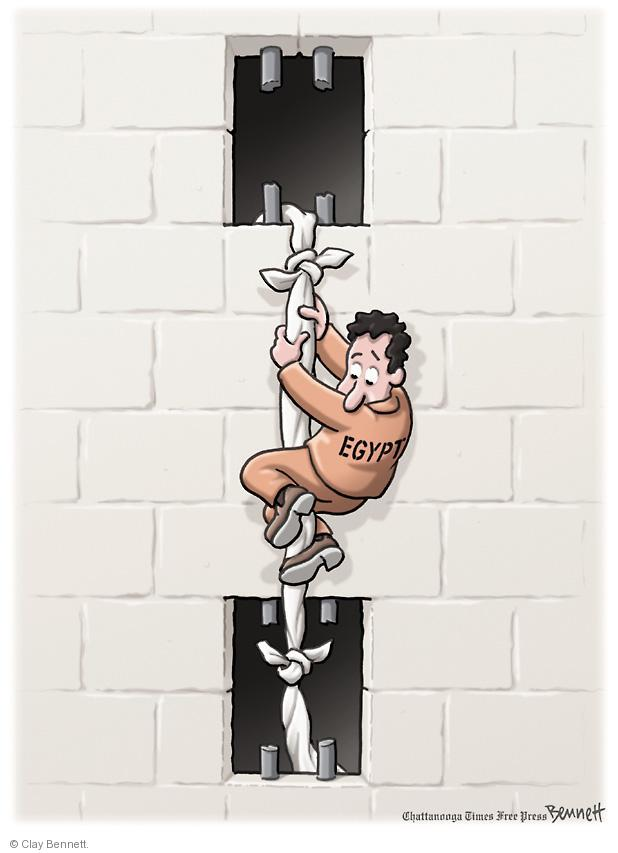 """No caption. (An Egyptian """"prisoner"""" escapes from one jail cell into another)."""