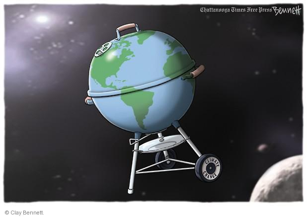 No caption. (Earth is seen in its orbit. The planet is shaped like a barbecue grill).