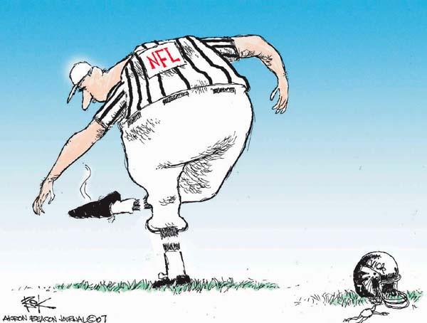 No caption.  (NFL referee checks bottom of his shoe as he stands near Michael Vicks helmet.)