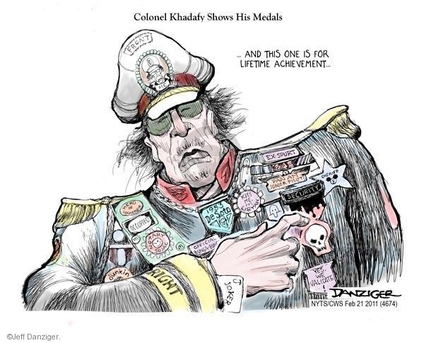 Colonel Khadafy shows his medals.  And this one is for lifetime achievement.   Security.  Front.  Me.  Occupied.  Notary Sojac.  Dunkin.  Right.  Joker.  1953 DeSoto.  Ex-Spurt.  Pan Am Honor Pilot.  Kiss Me Im Libyan. Sheriff.  Yes, we validate.