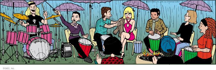 No caption. (Bernice, Tiffany, Gunther, Dez and friends play drums in the rain).
