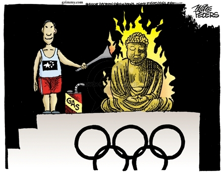 No caption.  (Chinese Olympic torch relay runner uses torch to ignite a statue of Buddha.)