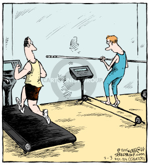 No caption. (In a gym, one man runs on a treadmill while another walks on a tightrope machine).