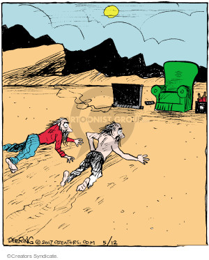 No caption (Two men crawl through the desert toward a recliner and television).