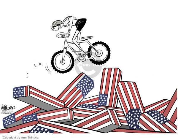 No caption. (George Bush jumps a bicycle over soldiers coffins).