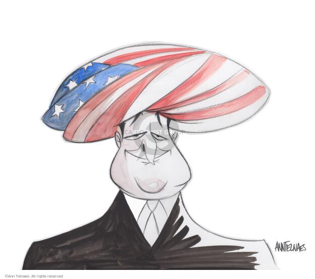 No caption. (Senator Ted Cruz wears a turban made from an American flag).