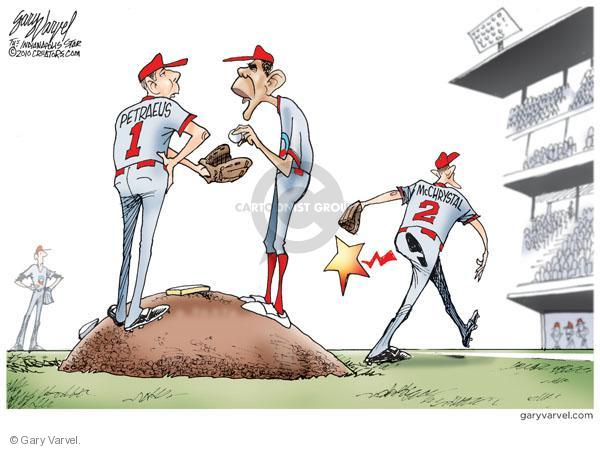 Petraeus. McChrystal. (President Obama and Generals McChrystal and Petraeus are depicted as baseball players. McChrystal is walking off the field with a shoe print on his butt as Obama gives the ball to Petraeus at the pitchers mound).